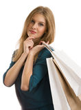 Portrait of young happy smiling woman with shopping bags Stock Photo