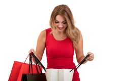 Portrait of young happy smiling woman with shopping bags, isolated over white background Stock Images