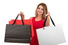 Portrait of young happy smiling woman with shopping bags, isolated over white background Royalty Free Stock Photo