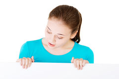 Portrait young happy woman with blank board Stock Image