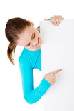 Portrait young happy woman with blank board Stock Photo