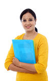 Portrait of young happy woman with blue folder. Against white royalty free stock images