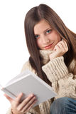 Portrait of young happy woman with book Royalty Free Stock Images