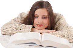 Portrait of young happy woman with book Stock Images