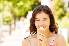 Portrait of young happy woman eating ice-cream royalty free stock photo