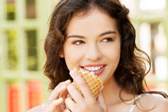 Portrait of young happy woman eating ice-cream Stock Photography