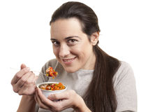 Portrait of young happy woman eating salad Stock Photos