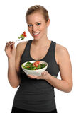 Portrait of Young Happy Woman Eating Salad Royalty Free Stock Photo