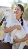 Portrait of young happy woman with goat Royalty Free Stock Photos