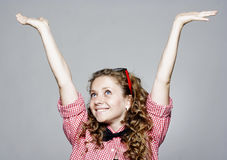 Portrait of young happy woman with hands up Royalty Free Stock Photo