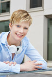 Portrait of young happy woman with headphones Stock Images