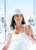 Portrait of a young and happy woman holding champagne Royalty Free Stock Image