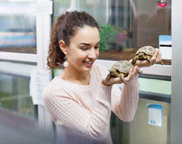 Portrait of young happy woman holding turtles Royalty Free Stock Photography