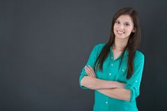 Portrait of a young happy woman isolated on a blackboard. Royalty Free Stock Photos