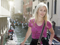 Portrait of the young happy woman  tourist on the channel background in Venice Stock Photo