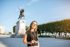Woman traveling in Montpellier city, France. Portrait of a young happy woman tourist at the famous Peyrou park near the Louis statue during the morning light in royalty free stock photos