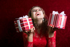 Portrait of young happy woman with two striped gifts. Royalty Free Stock Image