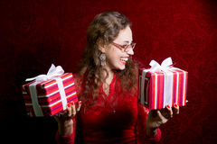 Portrait of young happy woman with two striped gifts Royalty Free Stock Photo