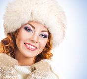 Portrait of a young and happy woman in a winter hat Stock Image