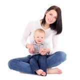 Portrait of young happy woman woth her little son sitting isolat Royalty Free Stock Photo