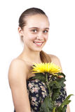 Portrait of young happy woman with yellow flower  Royalty Free Stock Images