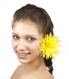 Portrait of young happy woman with yellow flower. On a white background royalty free stock photography