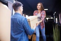 Couple Loading Moving Van Stock Image