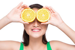 Portrait on young and healthy asian woman with orange isolated o Royalty Free Stock Images