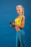 Portrait of young and healthy blonde with skipping rope Royalty Free Stock Images