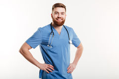 Portrait of a young healthy positive man doctor with stethoscope Stock Images