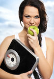Portrait a of young and healthy woman holding an apple Royalty Free Stock Photos