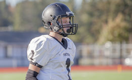 High school football player. A portrait of a young high school football player royalty free stock image