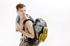 Portrait of young hiker with backpack on white background Royalty Free Stock Photography