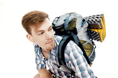 Portrait of young hiker with backpack on white background Stock Images