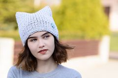Portrait of young hipster girl in grey wool cap Royalty Free Stock Image