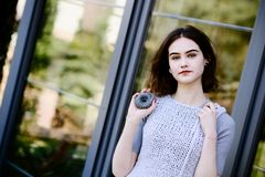 Portrait of young hipster girl in grey wool dress Royalty Free Stock Images
