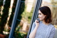 Portrait of young hipster girl in grey wool dress Stock Images