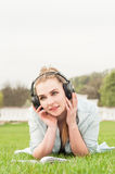 Portrait of young hipster girl relaxing outdoors and listening music Stock Photo