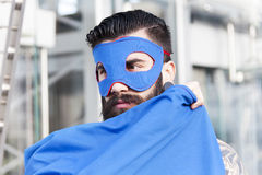 Portrait of young hipster superhero Stock Photography