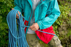 Portrait of a young hipster, training equipment for climbing. Stock Photo