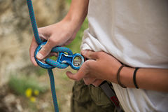 Portrait of a young hipster, training equipment for climbing. Royalty Free Stock Photo