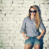 Portrait of Young Hipster Woman at the Brick Wall Royalty Free Stock Images