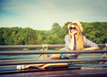 Portrait of Young Hipster Woman Relaxing in Park Stock Images