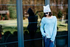 Portrait of young hipster woman on terrace. Royalty Free Stock Image
