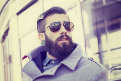 Portrait of young hipsters around the capital. Portrait of young hipsters businessman around the capital stock images
