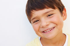 Portrait Of Young Hispanic Boy Standing By Wall Stock Image