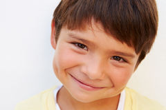 Portrait Of Young Hispanic Boy Standing By Wall Stock Photography