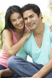 Portrait Of Young Hispanic Couple In Park Royalty Free Stock Image