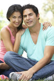 Portrait Of Young Hispanic Couple In Park Stock Image