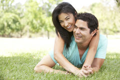 Portrait Of Young Hispanic Couple In Park Stock Photo